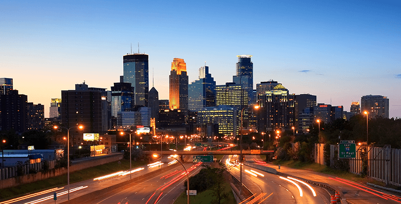 An evening sunset picture of Downtown Minneapolis.